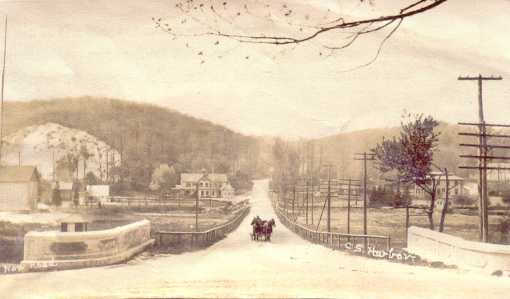 Photo of Route 25A looking west toward the Cold Spring Harbor Laboratory. Carnegie Library on right.